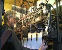 Martin Green working the knitting frame
