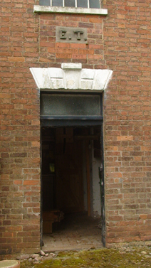 Door to Help Out Mill with the initials of Elijah Timms carved above